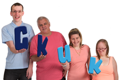 Group of people holding up CKUK